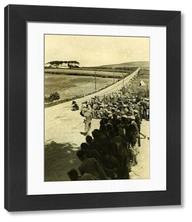 "10-times TT winner sweeps past a packed crowd at Hillberry. At this very spot, in 1922, he was watching the TT action and said to a friend ""I could do that"". 37 races, ten wins later, who would argue with that point"