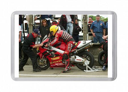 Davy Wood steadies the bike as Joey Dunlop brings his Honda SP1 in for a pit stop. Joey went on to win the 24th of his 26 TT victories