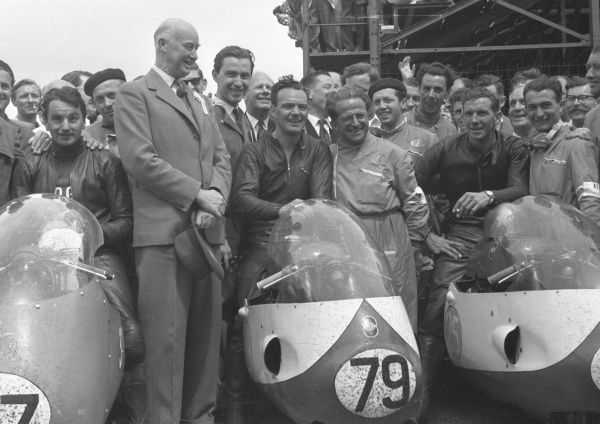 Winner Bob McIntyre (Gilera, 79) is flanked by Keith Campbell (Moto Guzzi) left and Bob Brown (Gilera) right in the winners enclosure for the 1957 Junior TT