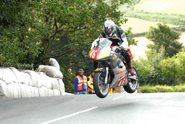 Andy Lawson (Suzuki) on Ballaugh Bridge: 2009 Newcomers Manx Grand Prix