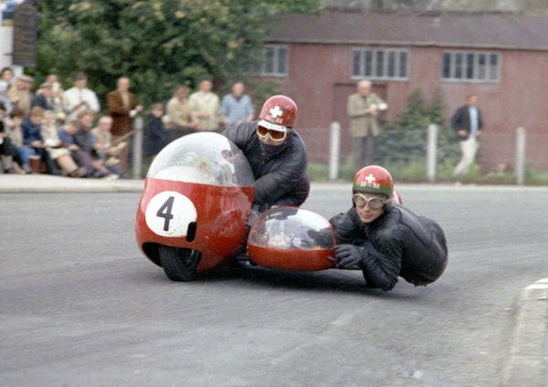 Johnny Robinson gazes into the camera lens as Fritz Scheidegger pours the power on. The Swiss / UK pairing only finished second in the 1965 Sidecar race but won the World Championship, repeating the feat in 1966