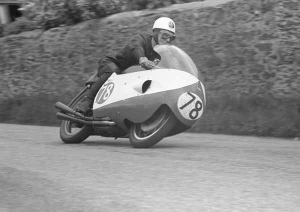 With Geoff Duke out injured, it was down to Bob McIntyre to set the first ton lap on the Mountain Course. Bob gives it full concentration round Cronk ny Mona