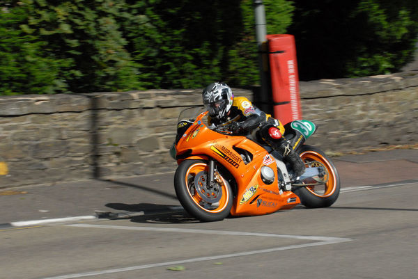 Carolynn Sells (Yamaha) on Quarter Bridge Road, winning the 2009 Ultra Lightweight Manx Grand Prix