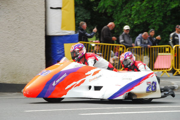 Darryl Rayner & Wendy Campbell (Shelbourne Honda) leave Ballaugh Bridge: 2018 Sidecar TT