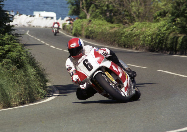 Beating the 120 mph barrier from a standing start, Steve Hislop, seen here at Tower Bends, was in a class of his own at the 1989 TT. He won F1, Supersport 600 and Senior TT races that year, a hat-trick he repeated in 1991