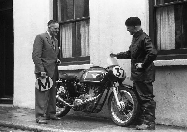 The first G50 Matchless. Development Engineer Jack Williams (left) discussses the bike with Vic Willoughby. Jack Wood was using it as a TM bike for the Manx, hence the plate in Jack's hand