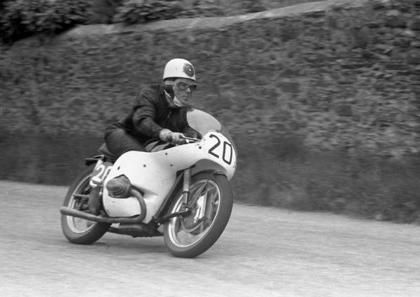 Geoff Duke at Cronk ny Mona in the 1958 Senior TT. Never really at home with the German twin, Geoff retired with brake trouble
