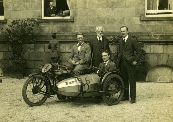 George Tucker and passenger Walter Moore are congratulated on their Sidecar TT victory by James 'Pa' Norton and fellow director Bill Mansell. Walter Moore was later to design the CS1 ohc Norton engine
