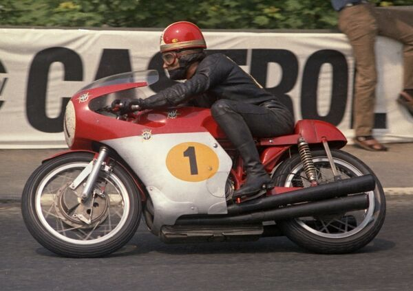 Winning the 1970 Senior TT, Giacomo Agostini became the first rider to win the Junior/Senior double on three consecutive years. A Parliament Square shot