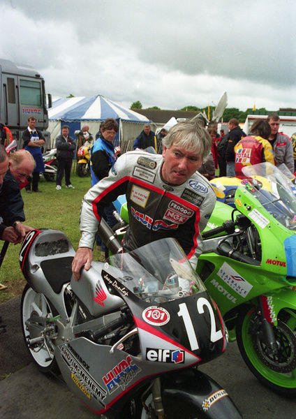 Joey Dunlop (Honda) prepares his machine for the 1999 Ultra Lightweight TT