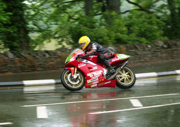 With the race shortened to three rain-sodden laps, Joey came out the traps like a greyhound, guessing that the weather would not improve. He was right, the race was red-flagged after two. TT win 23 was in the bag