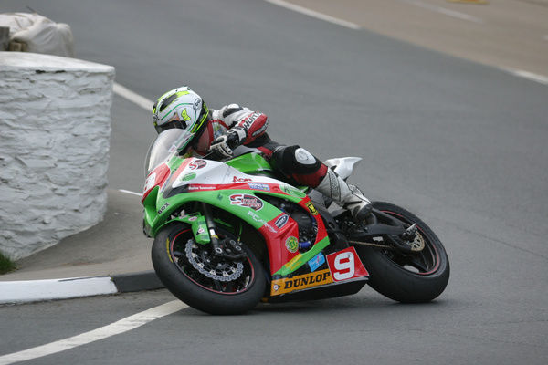 After a troubled practice session, Michael Dunlop seen here at Governors Bridge, gave the Kawasaki ZX10R its first TT win