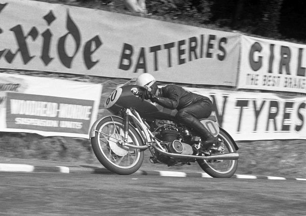 Les Graham joined the MV team in 1951 and won the 1953 Ultra Lightweight TT; seen here leaving Governors Bridge on his winning ride. He won the 1949 World 500 Championship on AJS