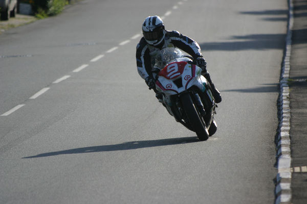 Michael Dunlop (Kawasaki) at Sulby Bridge: 2012 Superstock TT