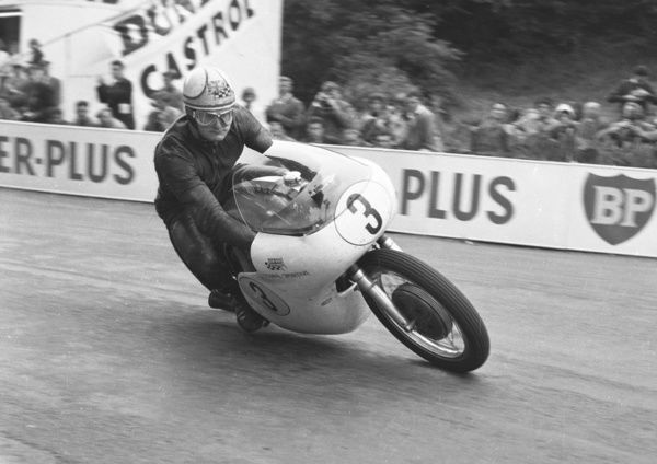 Heading for his first TT hat-trick, Mike Hailwood takes his Bill Stuart prepared Norton to victory in the 1961 Senior TT