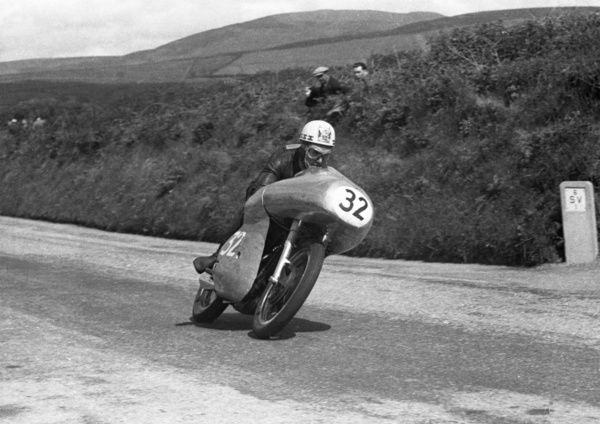 Rhodesian Ray Amm forces on through Cronk ny Mona on the distinctly-faired works Norton in the 1954 Junior TT. He won the Senior that year but retired from the Junior