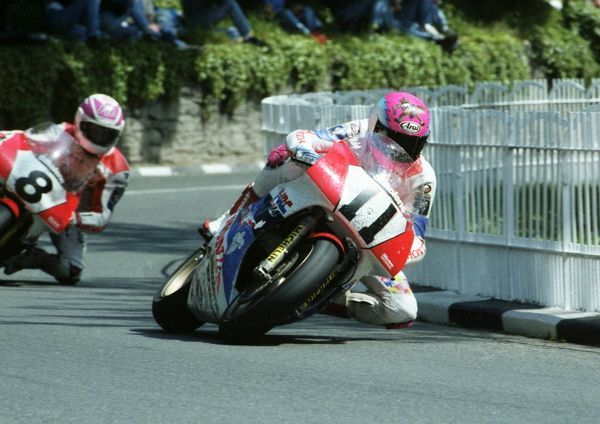 Steve Hislop is shadowed by his Honda team-mate Carl Fogarty at Braddan Bridge in the 1991 Formula One TT. Steve won, setting a new outright lap record at 123.48 mph and was clocked down the Sulby Straight at 192 mph