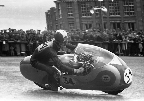 Italian ace Tarquinio Provini takes Parkfield Corner in the 1957 Ultra Lightweight TT. In retirement he produced the Protar plastic kits, one of which was this Mondial