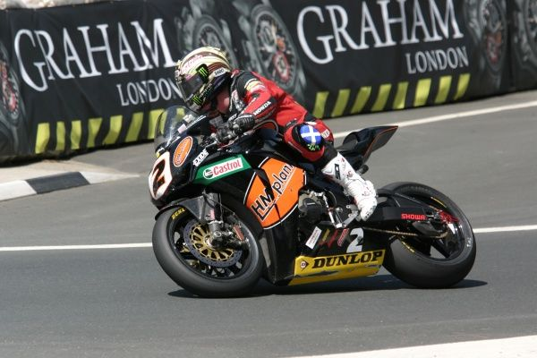 John McGuinness moved ahead of Mike Hailwood and Dave Molyneux in the TT winners list with victory in the 2009 Superbike TT