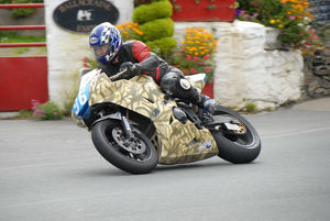 Tim Carrington (Triumph) 2009 Junior Manx Grand Prix